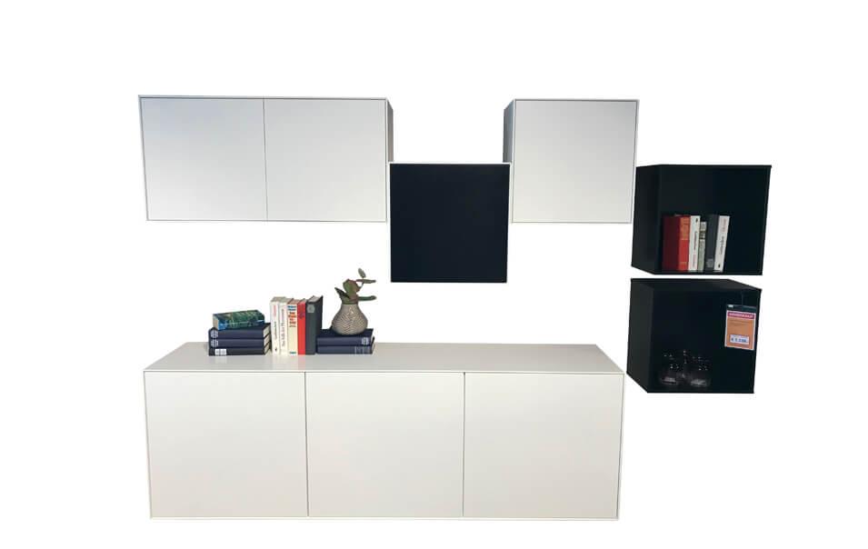 Wohnwand Henri als Ausstellungsstück im Abverkauf, in weiß und schwarz
